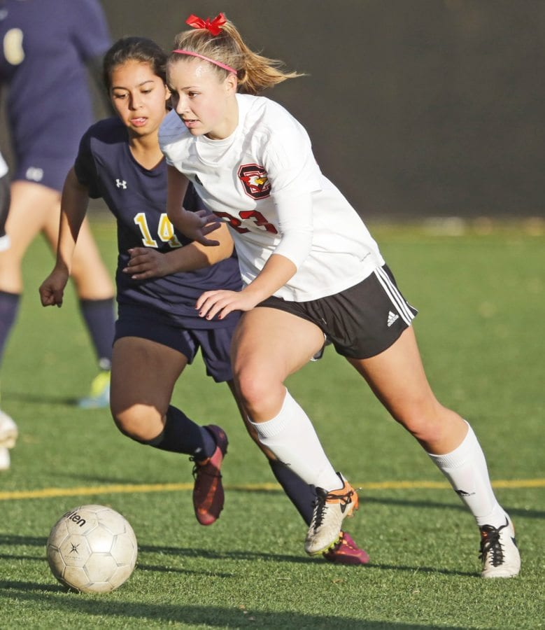 SCCS' Chloe Edwards (23) dribbles away from St. Monica's Academy's Deanelly Gonzales (14) during a soccer game at the Master's University on Friday. Katharine Lotze/Signal