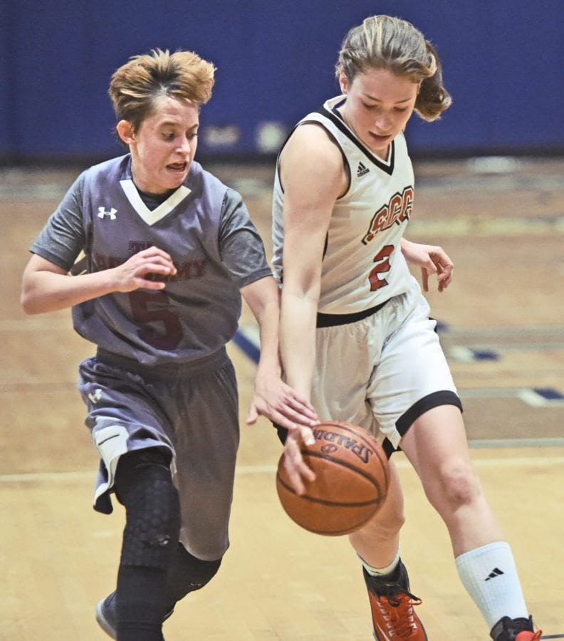 Albert EinsteinAcademy's Sam Steerba (5) and Santa Clarita Christian's Payton Schwesinger (2) fight for a ball at The Master's University on Friday.  Dan Watson/ The Signal