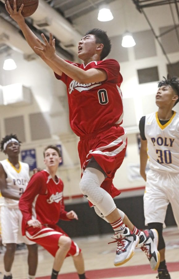 Hart's Jeremy Kim (0) goes up for a layup during a basketball game against Poly of Sun Valley at Hart on Thursday. Katharine Lotze/Signal