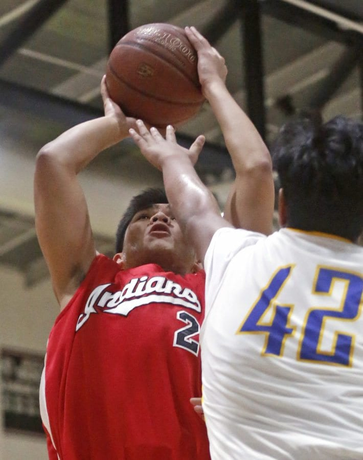 Hart's Renz Brual (2) goes up for a shot as Poly's Angel Verduzco (42) tries to block him during a game at Hart on Thursday. Katharine Lotze/Signal
