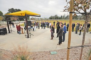 Attendees gather under cloudy skies at the official ribbon cutting of the 2.5 acre Marketplace Park in Valencia on Thursday, Santa Clarita's 34th Park.  Dan Watson/The Signal