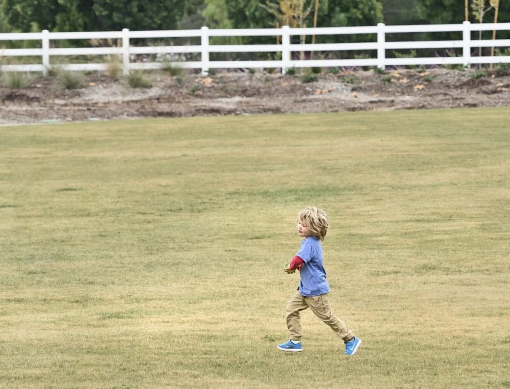 Jaden Hilsinger, 3, is the first official park user as he runs across the grass of the 2.5 acre, Marketplace Park after the ribbon cutting ceremony in Valencia on Thursday.  Dan Watson/ The Signal