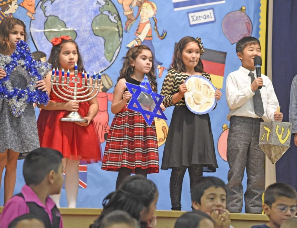 """Wiley Canyon Elementary School second-graders talk about Hanukkah traditions in Israel as four classes of second-graders present their show entitled """"Holiday Traditions Around The World"""" in Newhall on Thursday.  Dan Watson/The Signal"""