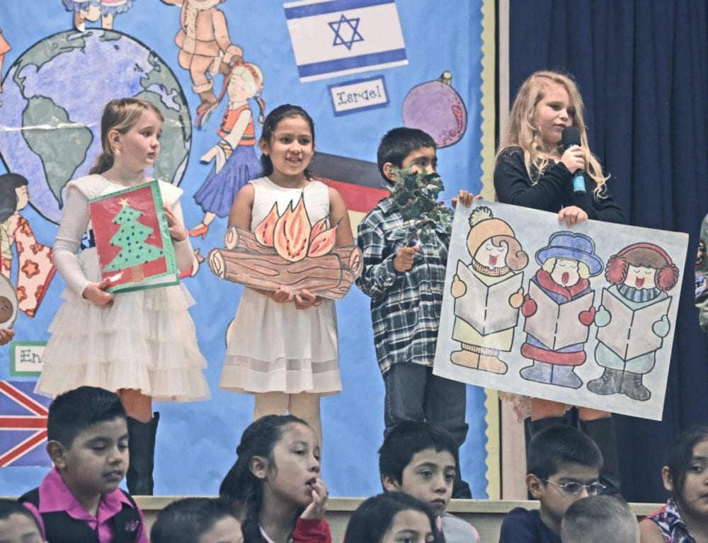 """Wiley Canyon Elementary School second-graders tell about Christmas traditions created in England as four classes of second-graders present their show entitled """"Holiday Traditions Around The World"""" in Newhall on Thursday.  Dan Watson/The Signal"""