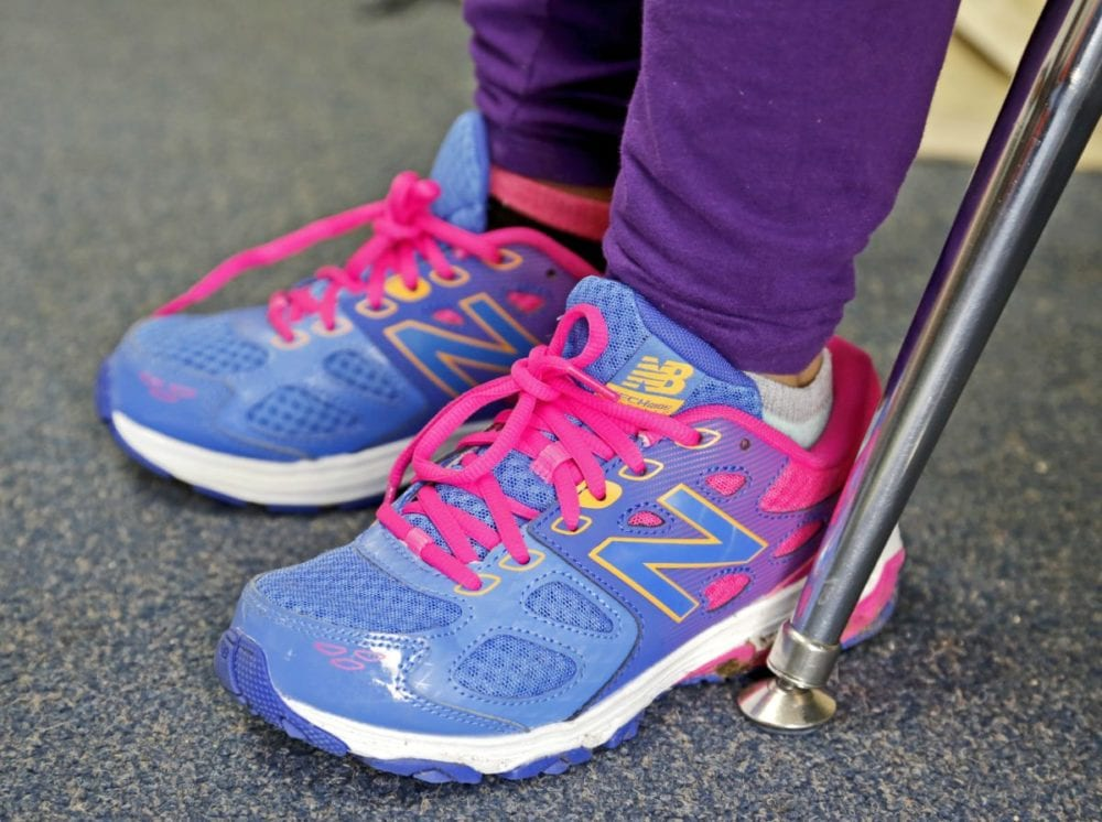 A student wears the shoes she received from P.E. teacher Samantha Ford's shoe drive at Cedarcreek Elementary in Canyon Country on Wednesday. Katharine Lotze/Signal
