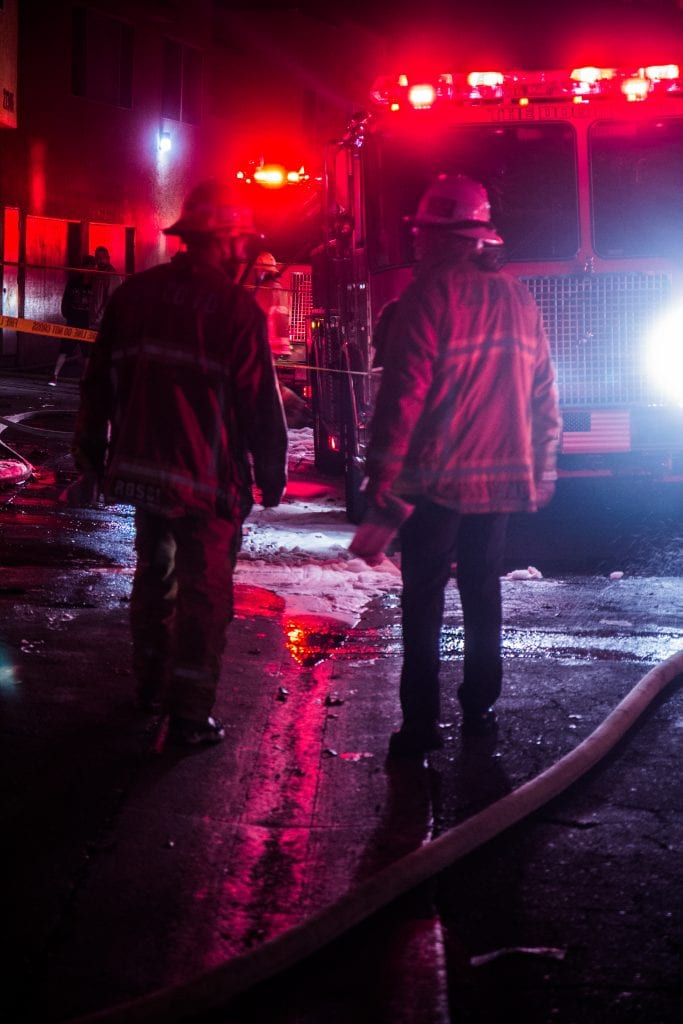 A fire captain walks with Battalion Chief Darus Ane at the scene of an apartment fire Tuesday morning. Austin Dave/SIGNAL