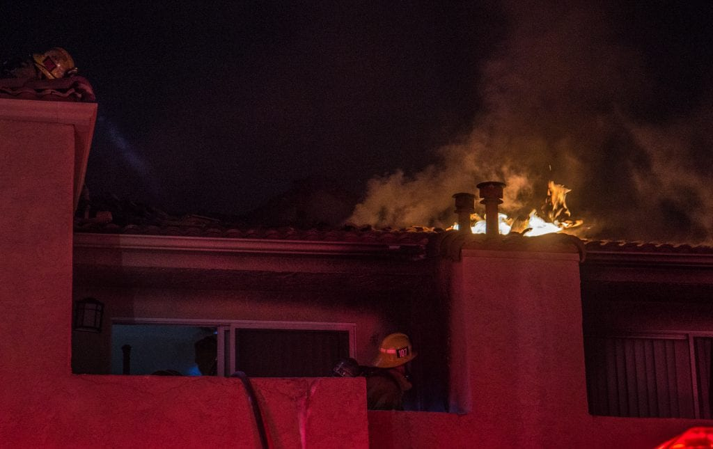 Fire erupts from the rooftop of a Canyon Country apartment building early Tuesday morning. Austin Dave/SIGNAL