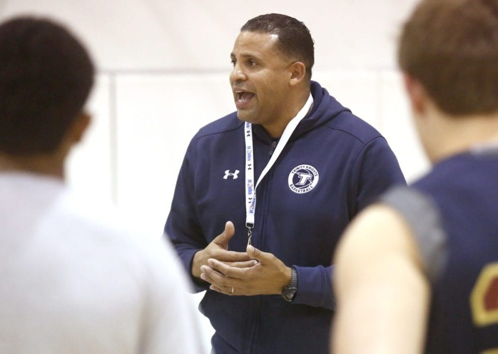 Trinity boys varsity basketball head coach Tod Bernard talks to his players during a practice on Monday at the Henry Mayo Health and Fitness Center in Valencia. Katharine Lotze/Signal