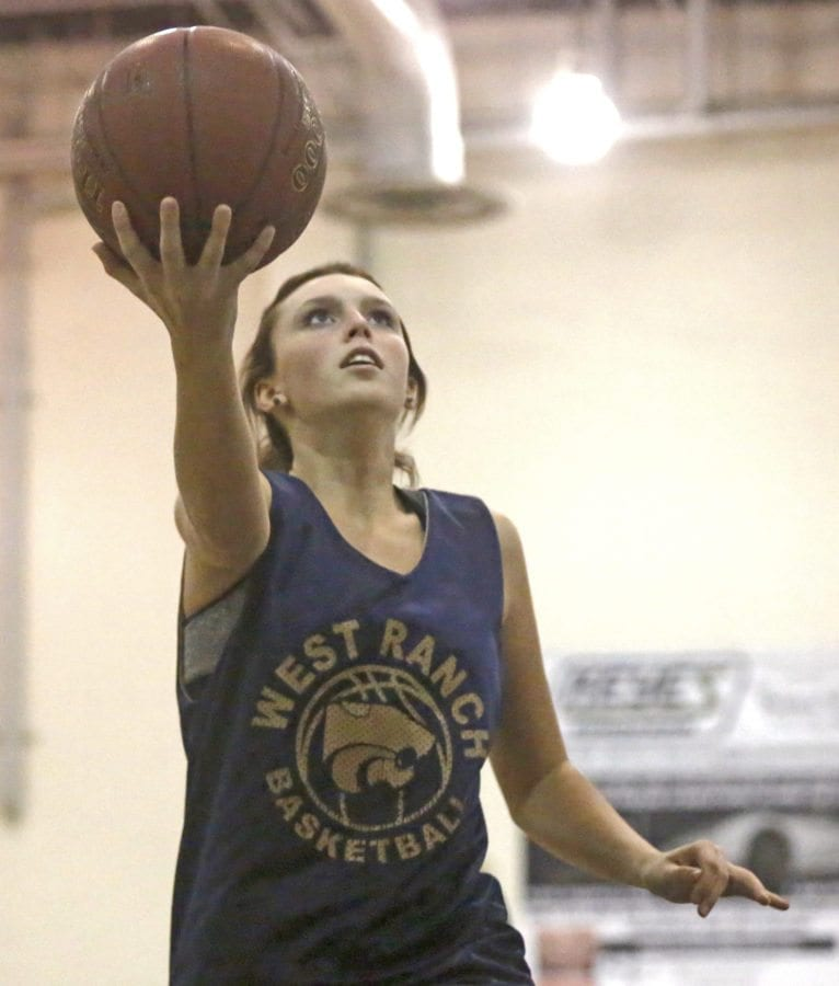 West Ranch's Eleanor McQuillen looks for the lay up during practice on Dec. 8. Katharine Lotze/Signal