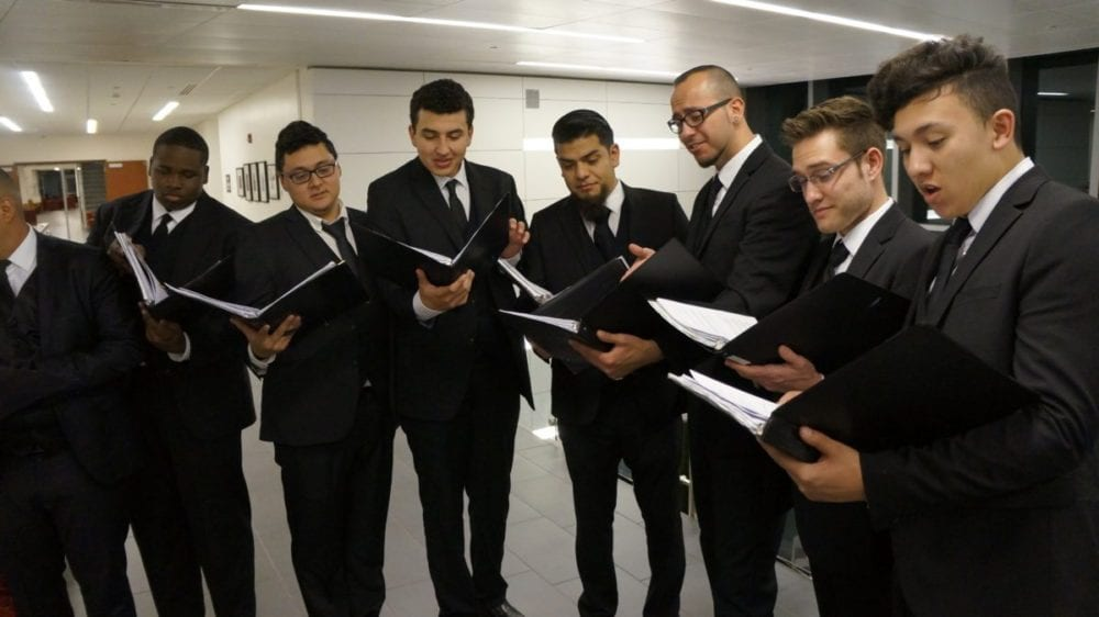 Tenors and basses warm up before singing at College of the Canyons on Saturday. Samie Gebers/ The Signal