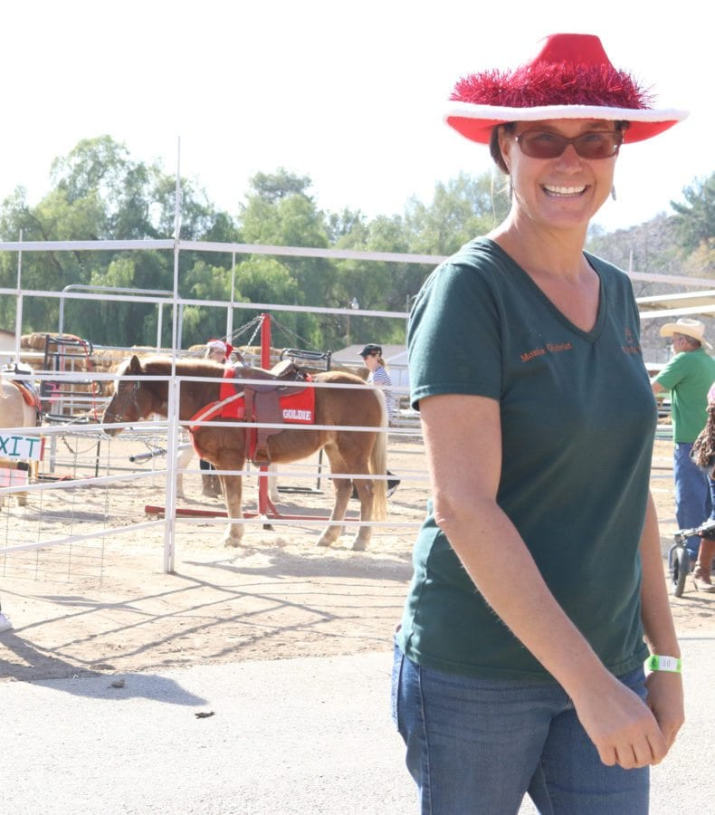 Monica Gilchrist, the organizer of the Holiday Hoedown, stands in front of the ponies at the Gilchrist Farm on Saturday near Saugus. Nikolas Samuels/The Signal