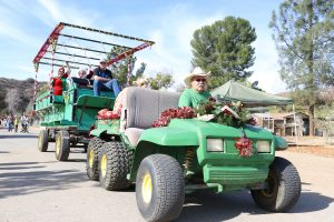 People participate in the wagon ride on a John Deere tractor at the Holiday Hoedown at the Gilchrist Farm near Saugus on Saturday. Nikolas Samuels/The Signal