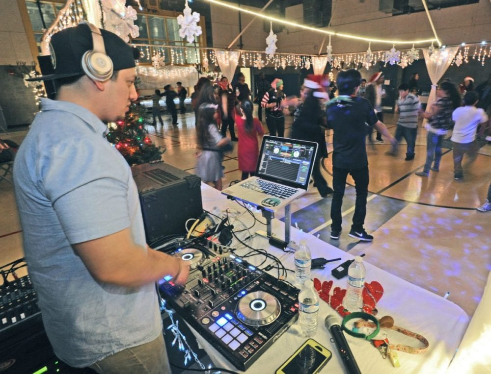 Dozens of attendees dance as DJ, Joe Arambula plays music at the at the Newhall Community Center's Holiday Family Party in Newhall on Friday. Dan Watson/the Signal