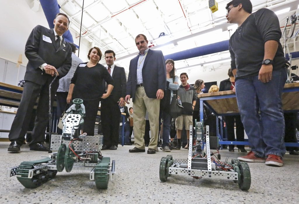Saugus High School students show off robots to attendees of the school's makerspace ribbon cutting on Friday. Katharine Lotze/Signal