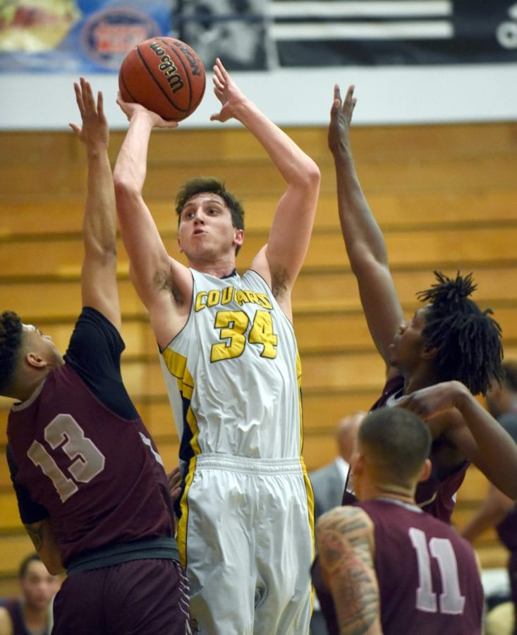 COC's Jason Horonsy takes a shot against Antelope Valley College defenders on Friday night. (Photo by Terri Thuente/for The Signal)