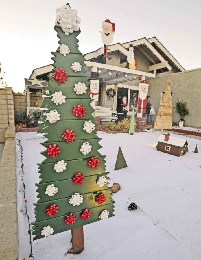 "Bob Dodge's display of unique hand made Christmas trees entitled the "" Land of Misfit Trees"" in Bob's Front yard. Dan Watson/The Signal"