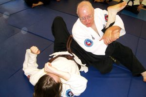 Sensei George Kirby demonstrating the proper technique used in the knee brace nerve press submission. Courtesy photo