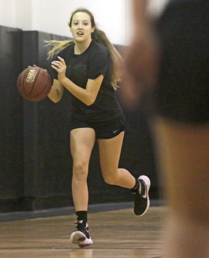 Santa Clarita Christian's Aaronya Crosswhite dribbles down the court during Wednesday's practice. Katharine Lotze/Signal