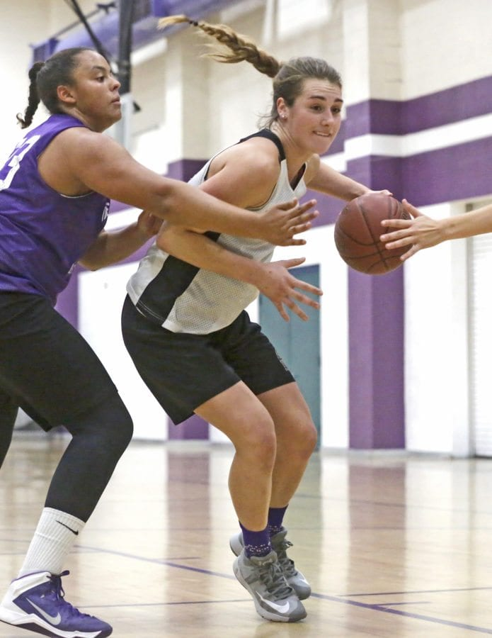 Valencia's Kayla Konrad (23) drives through the defense during a drill at Monday's practice. Katharine Lotze/Signal