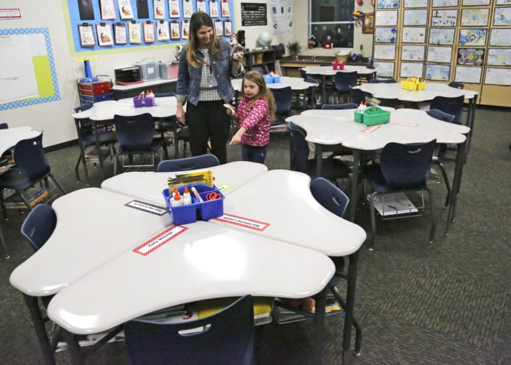 Callah Yoscovitz, 5, points out a desk group to her mom, assistant principal of Old Orchard Elementary Lisa Seeley-Yoscovitz as they tour the new modular classrooms at Peachland Elementary in Newhall on Wednesday. Katharine Lotze/Signal