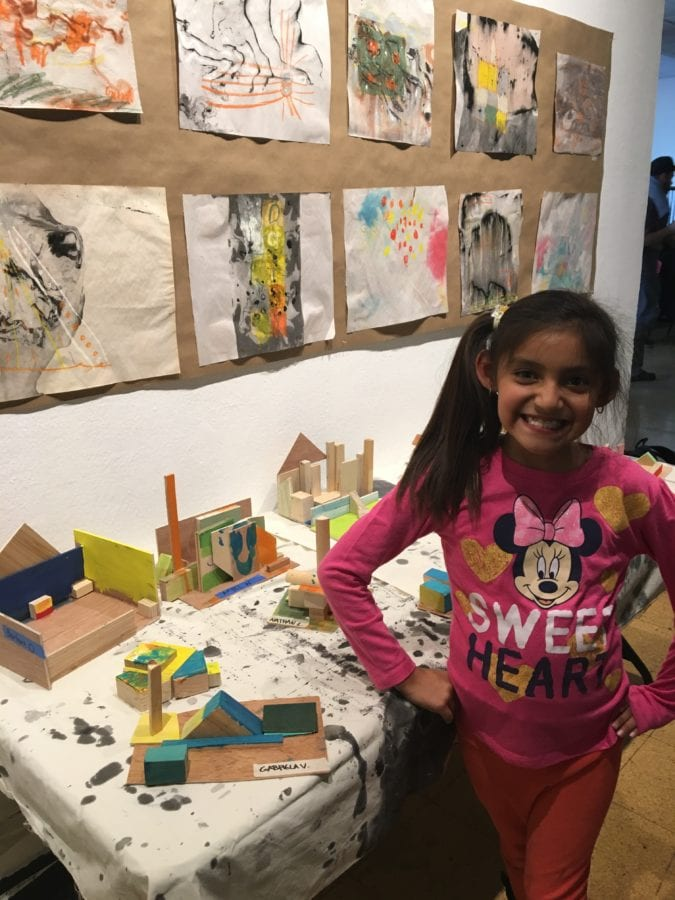 A student from Newhall Newhall Elementary School stands in front of her completed artwork on display at California Institute of the Arts this week as part of a completed fall session of the school's Community Arts Partnership (CAP).  Courtesy of Jane D'Anna