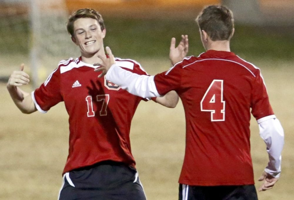 Santa Clarita Christian's Billy Latch (17) celebrates his goal, from a free kick at nearly half-field, with teammate Chris Siddens (4) during a game against Albert Einstein Academy at Central Park on Tuesday. Katharine Lotze/Signal