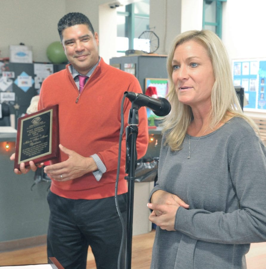 Boys & Girls Club of Santa Clarita Valley CEO David Menchaca, left, presents the Tony Newhall Volunteer of the Year Award to Ann-Marie Bjorkman and her husband Mike( not shown) at the Boys & Girls Club of Santa Clarita Valley 2016 Holiday Luncheon held at the Boys & Girls Club of Santa Clarita Valley in Newhall on Tuesday. Dan Watson/The signal