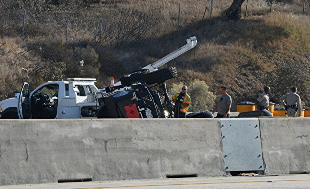 A trailer overturned on the northbound 14 just south of Newhall Avenue Monday afternoon.  Photos by Rick McClure, for the Signal.