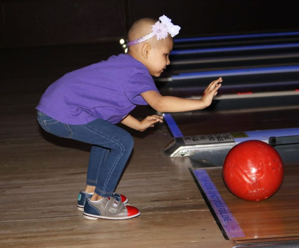 Aaliyah Delgado, a 3-year-old leukemia patient who receives treatment at Children's Hospital Los Angeles (CHLA), participates in Bowling for Kids, an event to raise funds for CHLA at Valencia Lanes on Sunday. Nikolas Samuels/The Signal
