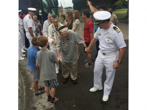 People help the veterans on their trip to Pearl Harbor.
