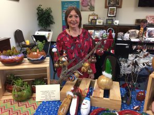 Vendor Eisenman stands by her homemade gourd products on Saturday at the Holiday Boutique at Home Care Services. Samie Gebers/ Signal
