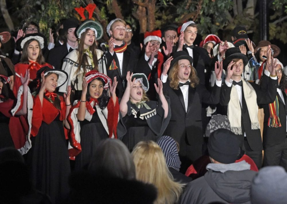 The Valencia High School Chamber Choiroo sing Christmas carols at the 11th annual Military Tree Lighting at Veterans Historical Plaza in Newhall on Saturday. Dan Watson/The Signal