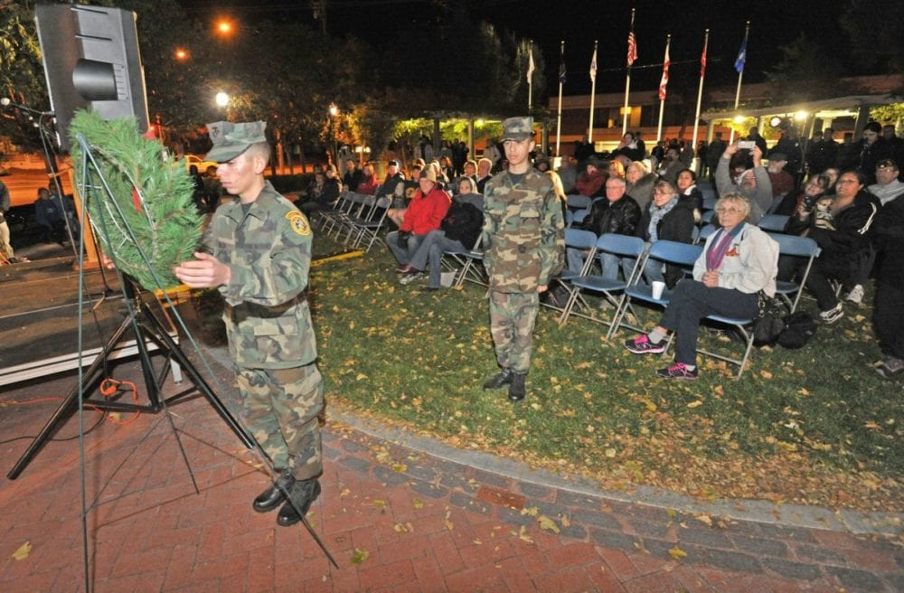 Members of the Santa Clarita Valley Young Marines place a wreath for fallen veterans at the 11th annual Military Tree Lighting at Veterans Historical Plaza in Newhall on Saturday. Dan Watson/The Signal