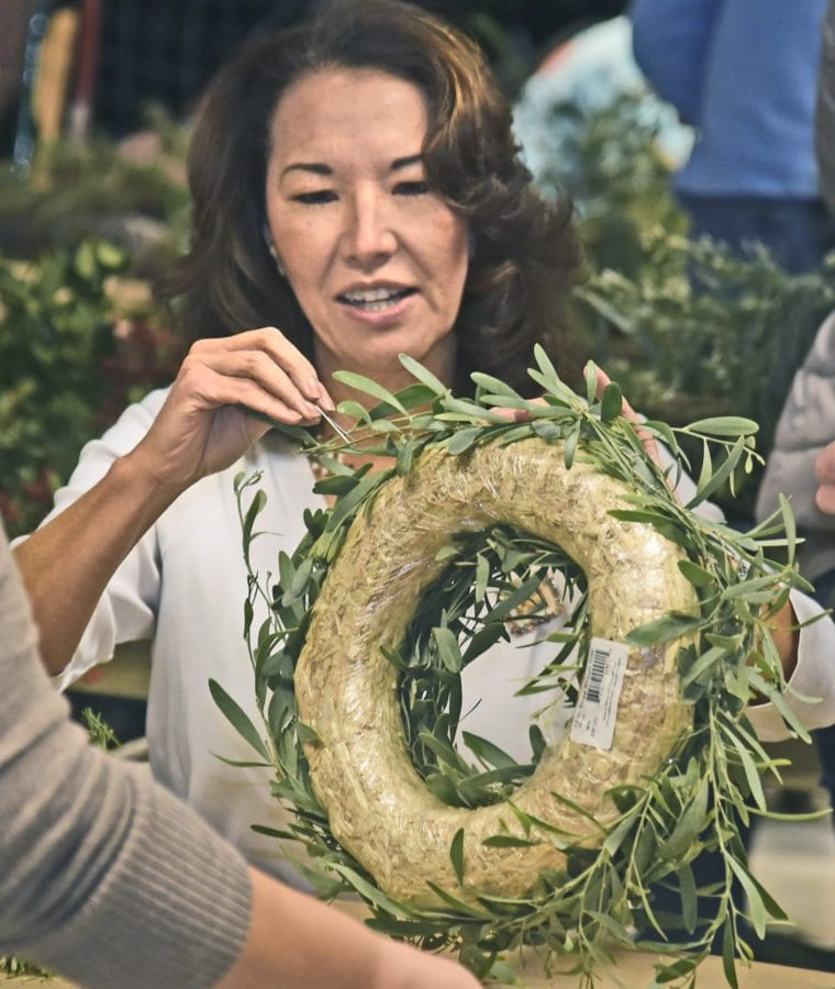 Lynda Davidson of Auga Dulce decorates her wreath at the annual Holiday Craft Fair on Saturday which has been held at the Placerita Canyon Nature Center for more than 35 years in Newhall. Dan Watson/The Signal