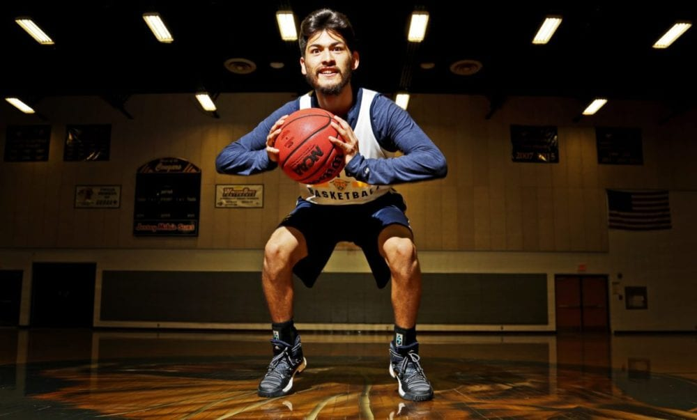 College of the Canyons basketball player Matt Flores poses for a portrait at the school's gym on Wednesday. Katharine Lotze/Signal