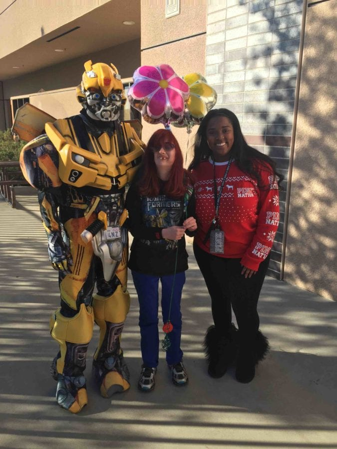 """Cheyenne Hughes, 15, is flanked by an Optimus Prime character from the movie """"Transformers"""" at Golden Valley High School. Courtesy photo"""
