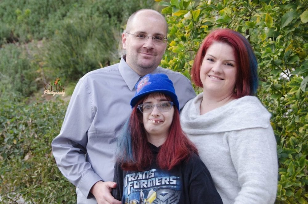 Paul and Amy Hughes flank their daughter Cheyenne, 15, in a photo. Photo courtesy Courtney Tole, CLTG Photography