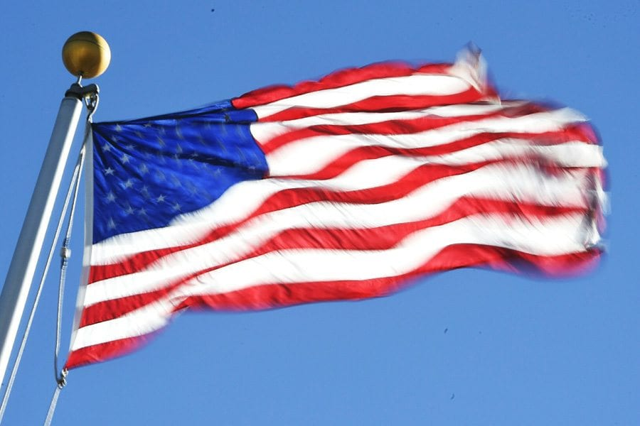 High winds bulow the American flag flying over Rio Norte Junior High School in Valencia on Friday. Dan Watson/Signal