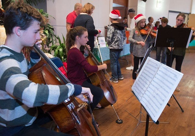 Photos courtesy of Saint Kateri Catholic Church Parish members offered music to attendees during last year's event with a performance by a string quartet during the event.