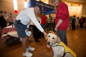 Photos courtesy of Saint Kateri Catholic Church Guide Dogs of America hosted a booth at last year's event to raise awareness for the need for puppy raisers, or host homes for dogs training to become guides to serve those with disabilities.