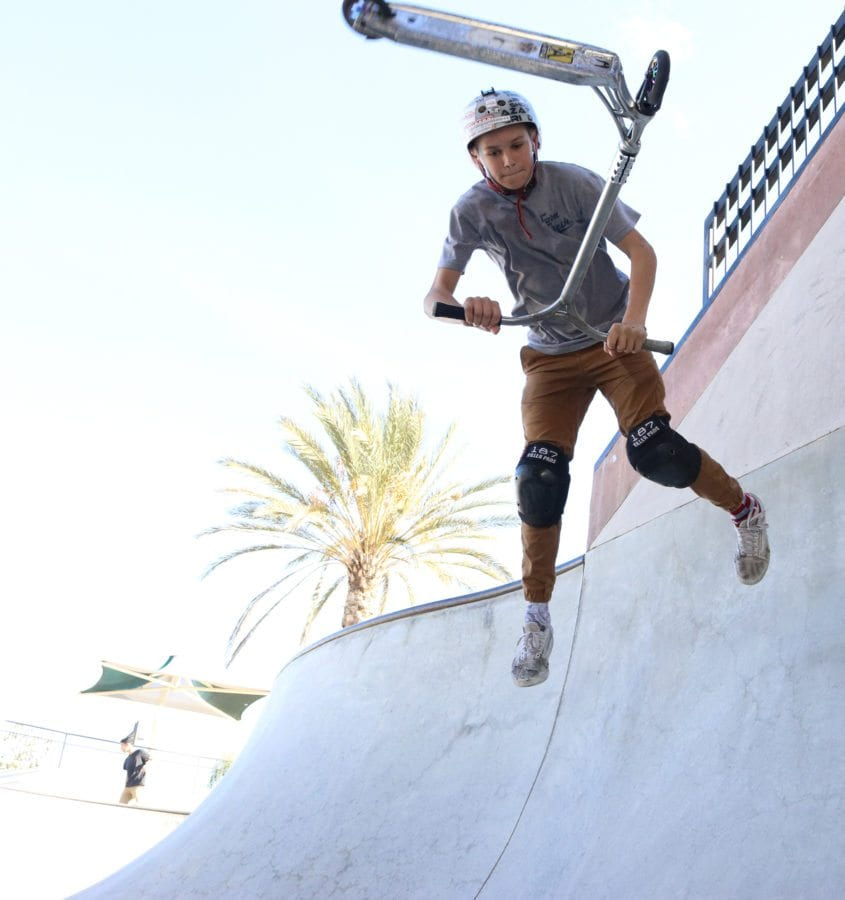 Dominic Deeder does a trick on his scooter at the Santa Clarita Skatepark on Sunday. Nikolas Samuels/The Signal