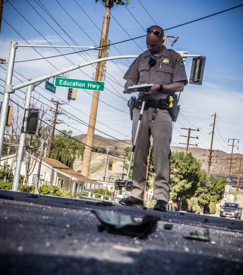Officials investigate the scene of a hit and run on the 16000 block of Sierra Highway on Sunday. Austin Dave/ Signal