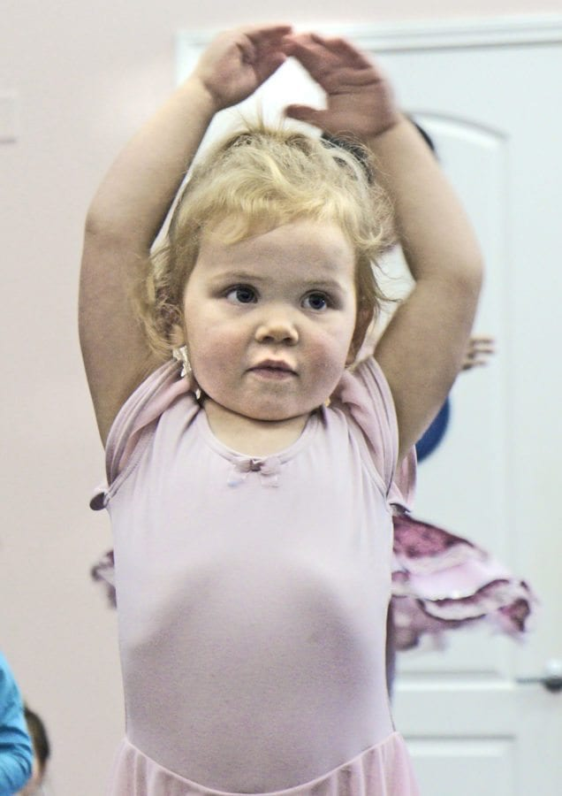 Cora James, 2, holds a pose during freeze dance at Tutu Ballet Academy on Sunday. Samie Gebers/ Signal