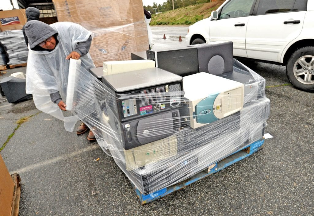 A worker wraps a pallet of computers that were dropped off for recycling during the e-waste recycling event hosted by William S. Hart High School at College of the Canyons in Valencia on Saturday. Dan Watson/The Signal