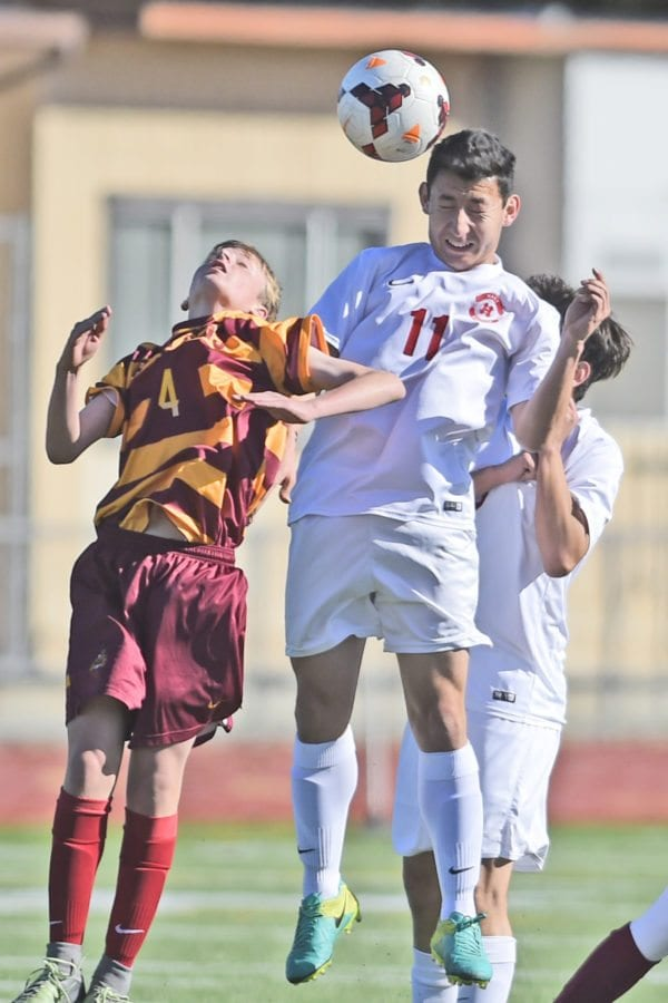 Hart's Jesus Trejo (11) heads the ball away from La Canada defender at hart on Friday. Dan Watson/The Signal