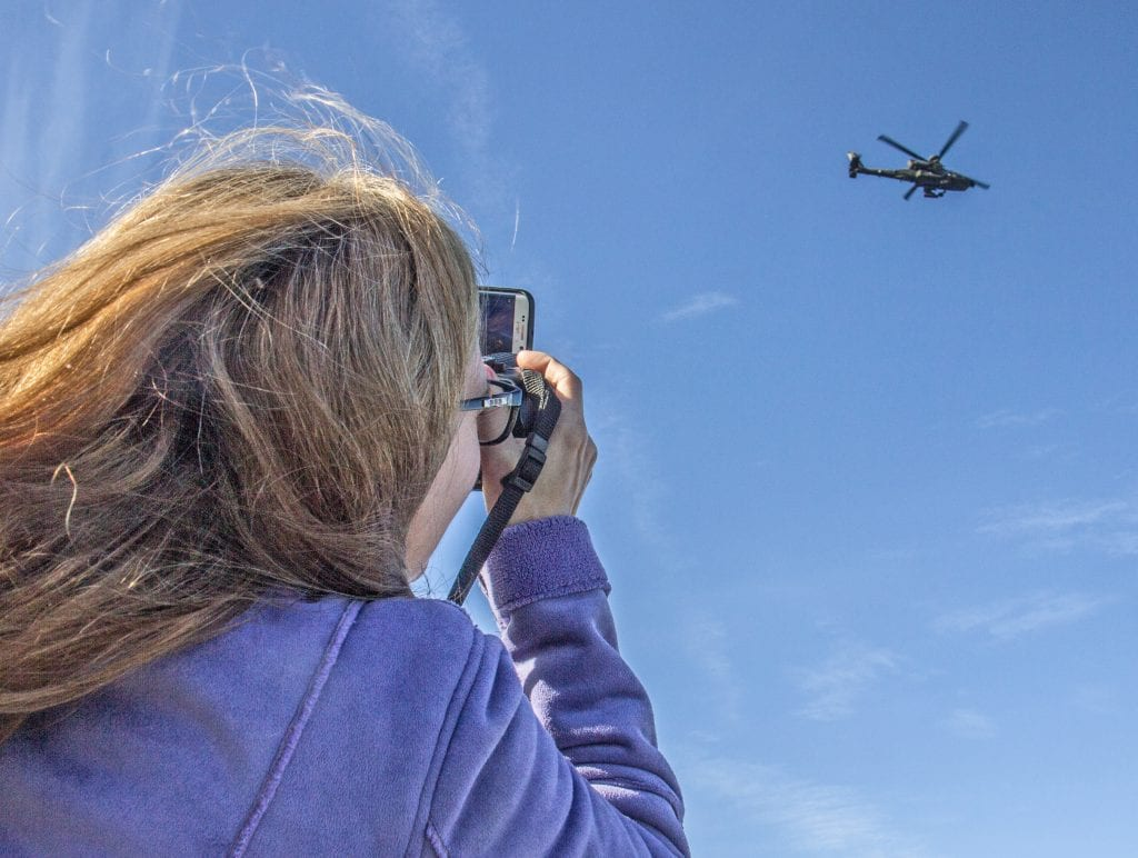Spectators turn out to catch fly over of Apache helicopters. Photo by Austin Dave, The Signal.