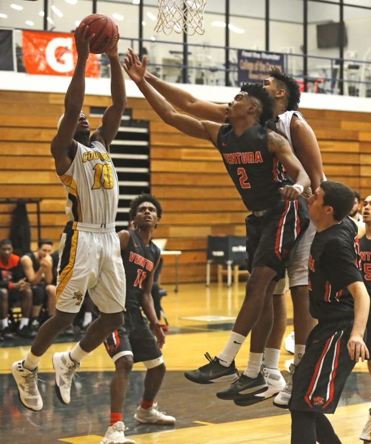 College of the Canyons' Michael Kalu (10) goes up for a shot as Ventura's Calvin Young (2) tries to block him during a basketball game at COC on Thursday. Katharine Lotze/The Signal