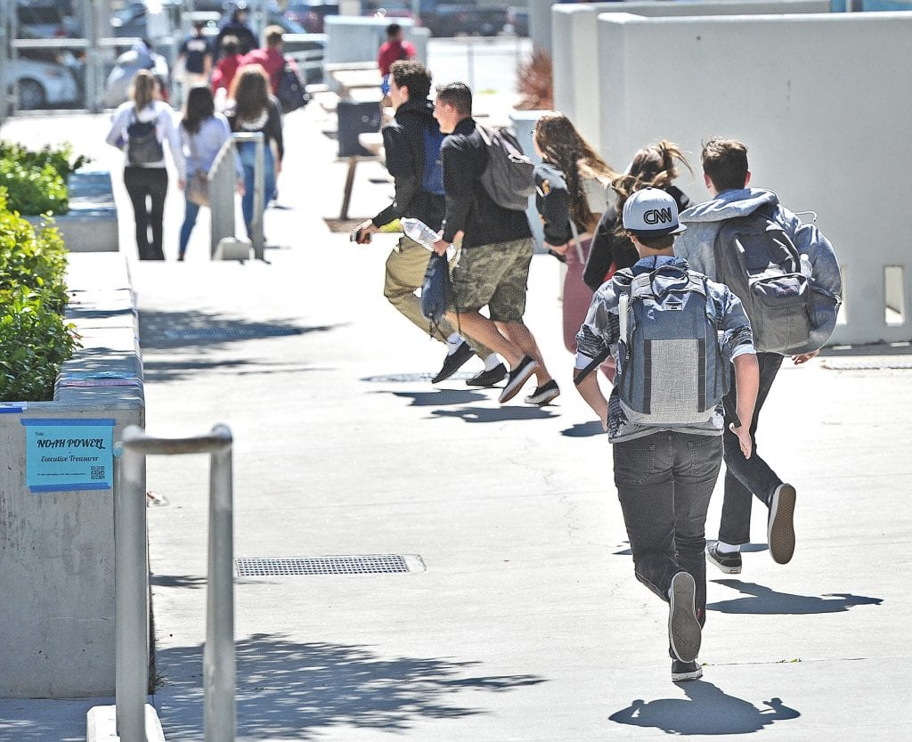 Some of Saugus High School's 2,300 students rush to the nearest classroom during a lock-down training exercise held during a passing period between classes at Saugus High School on Thursday morning. 033116 DAN WATSON
