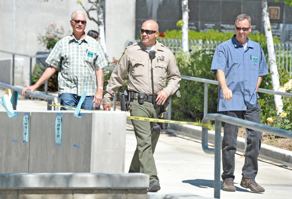 L.A. County Sheriff's personnel from Left, Sergeant Robert Wachsmuth, Retired, Deputy Toby Coe, Detective Bill Velek, walk the campus as thye observe a lock-down training exercise held at Saugus High School on Thursday morning. 033116 DAN WATSON