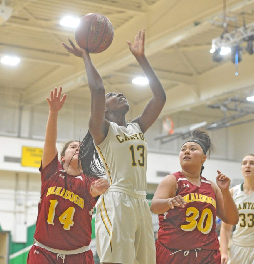 Canyon's Selasi Mawugbe (13) scores against Highland defenders at Canyon on Tuesday. Dan Watson/The Signal